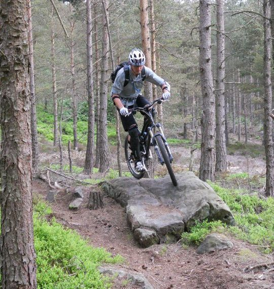 Cycling in Thrunton Woods, Adventure Northumberland